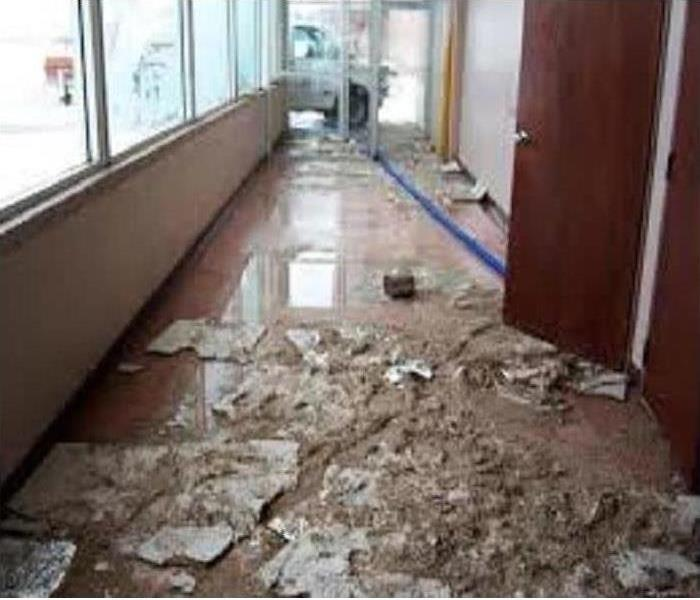 Business Hallway floor with severe water damage