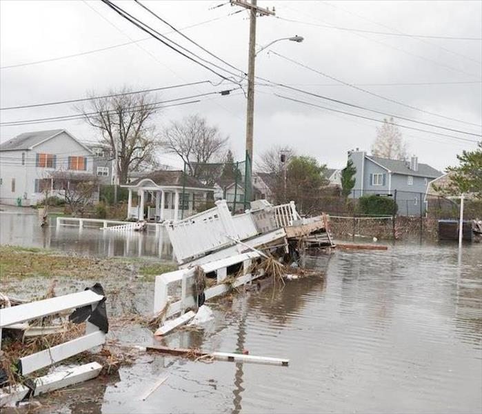 Storm Damage Hazardous Waste Filled Flood Damage During Seasonal Downpours in Grafton